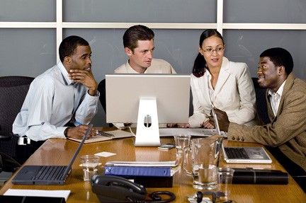 Image of business professionals taking a training program together.