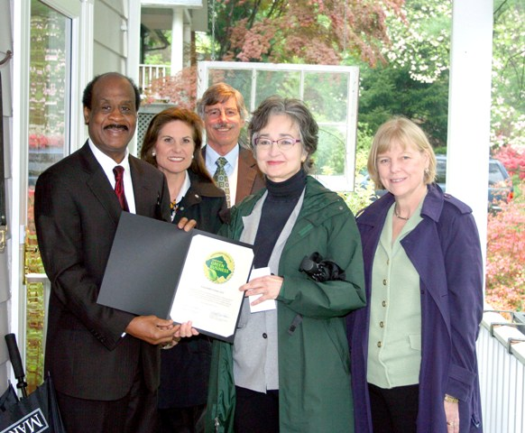 Image of a green landscaper receiving her certification from the County Executive, Council member Nancy Floreen and other county officials.