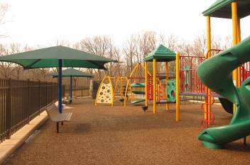 This photo shows an accessible playground that meets the new ADA requirements for recreational facilities. The playground is located at the White Oak Community Center in Silver Spring.