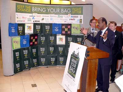 Against a backdrop of reusable bags, County Executive Ike Leggett speaks at the launch event, held at Westfield Montgomery, for the new bag law outreach campaign