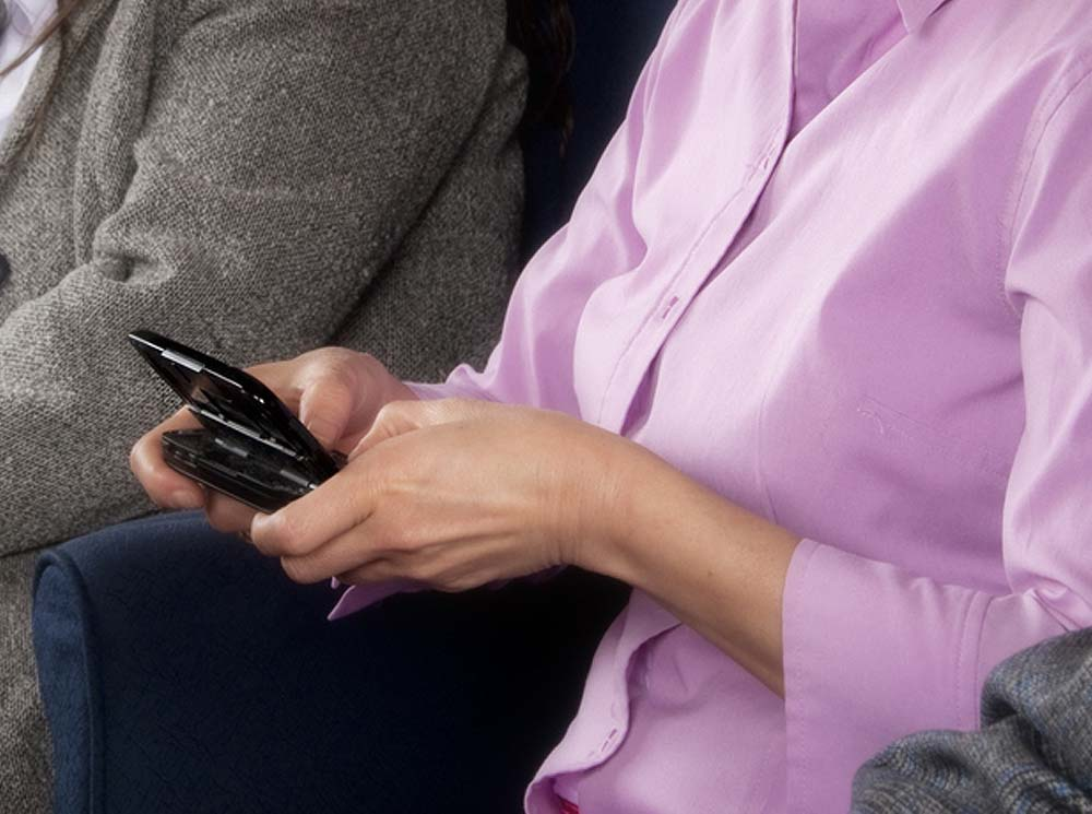 Juror typing on electronic device
