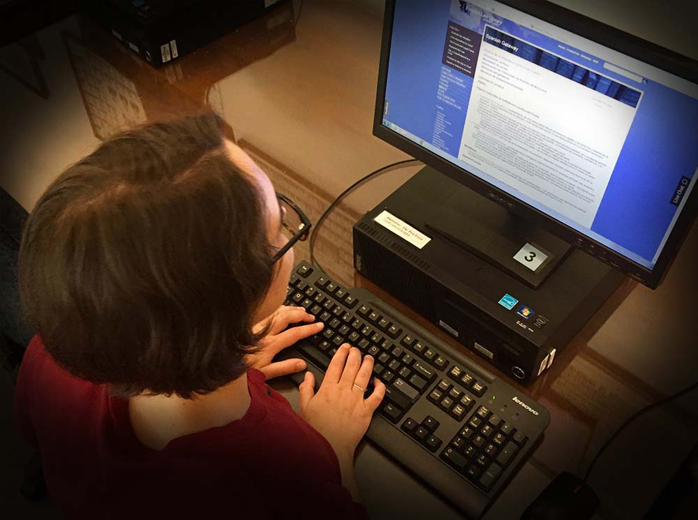 Woman typing legal terms into computer