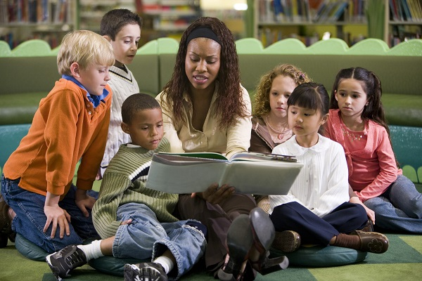 women reading to children