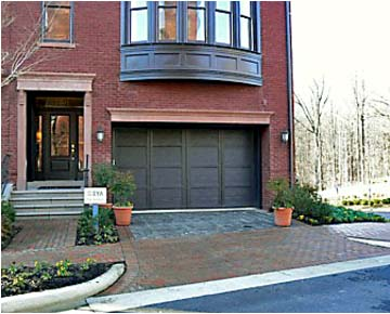 brick  townhouse with garage