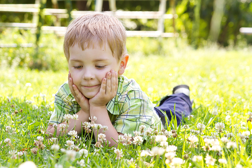 Child in grass with clover