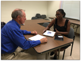score counselor works with business owner