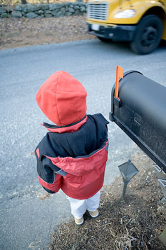 Child Pedestrian Safety - child in front of mailbox waiting for bus