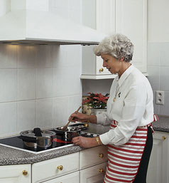 Woman cooking on stove top
