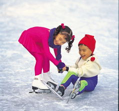 Two children ice skating.  Be Safe while Ice Skating