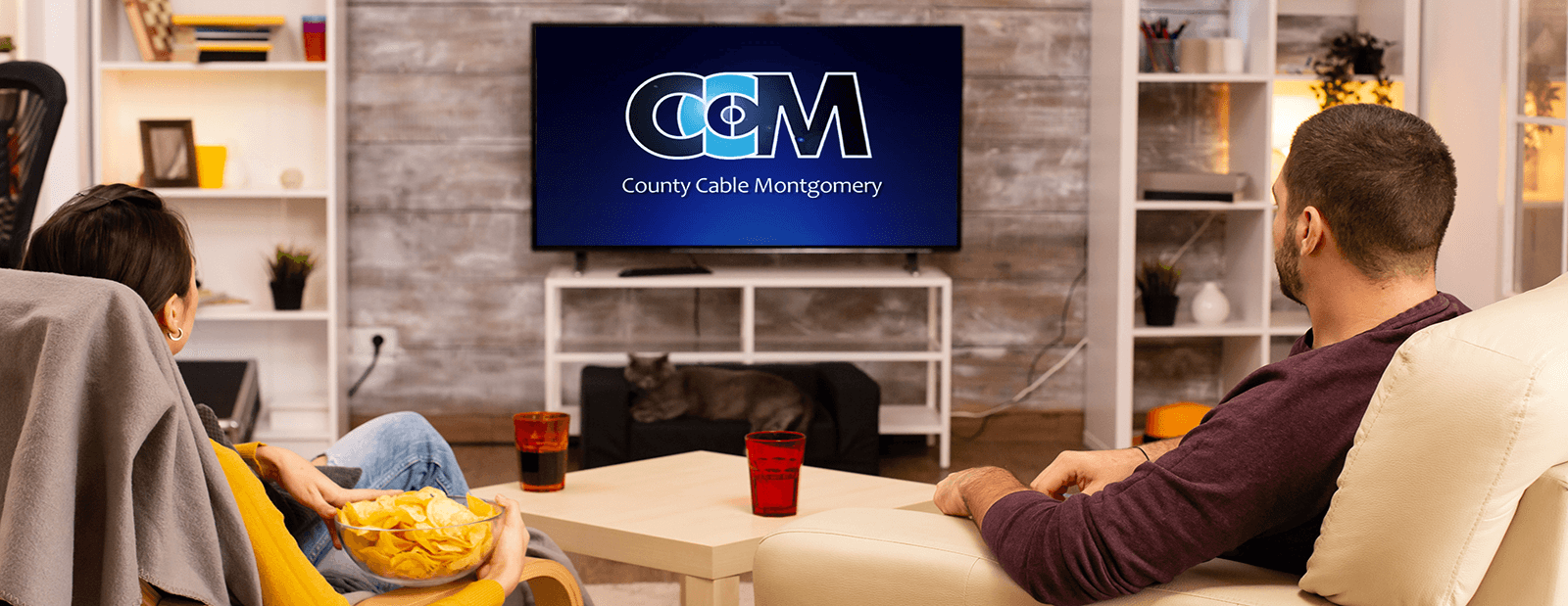 County Cable Montgomery - Image of family watching tv