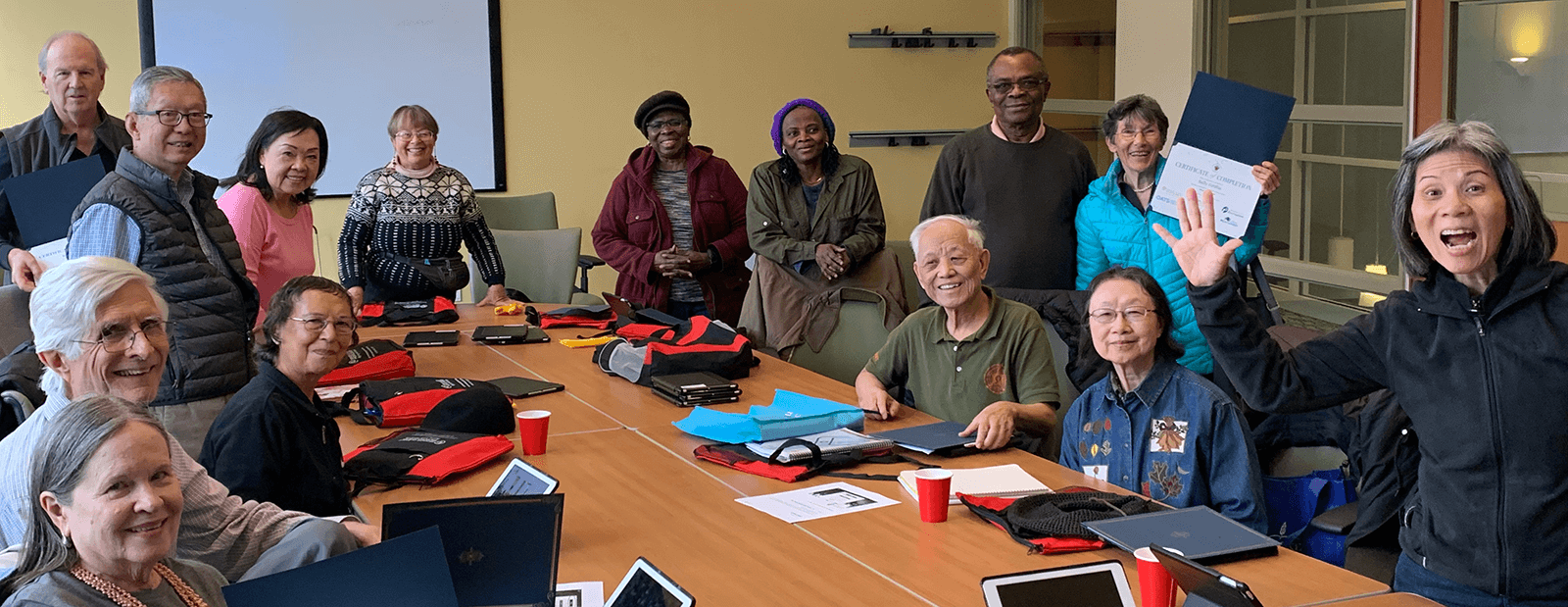 Digtal Equity Slider - Image of a group of seniors learning to use technology