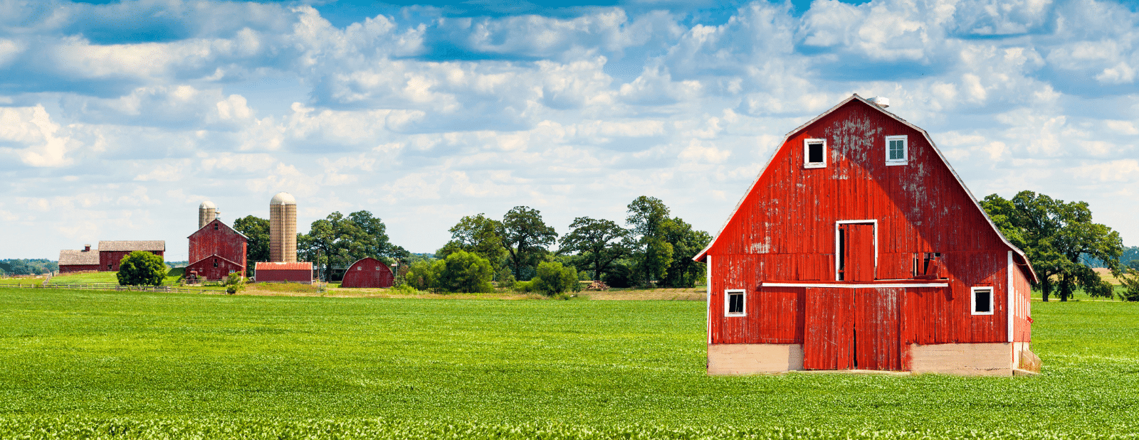 Rural Broadband Report - Image of a red barn in a field