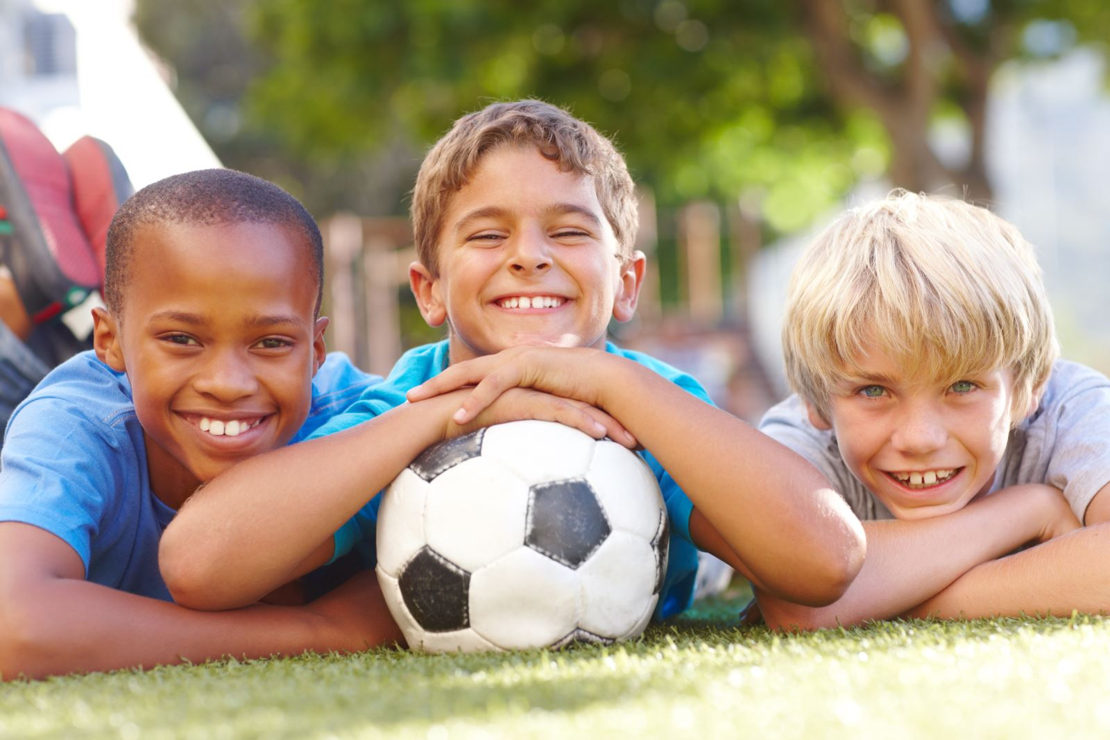 three boys with soccer ball