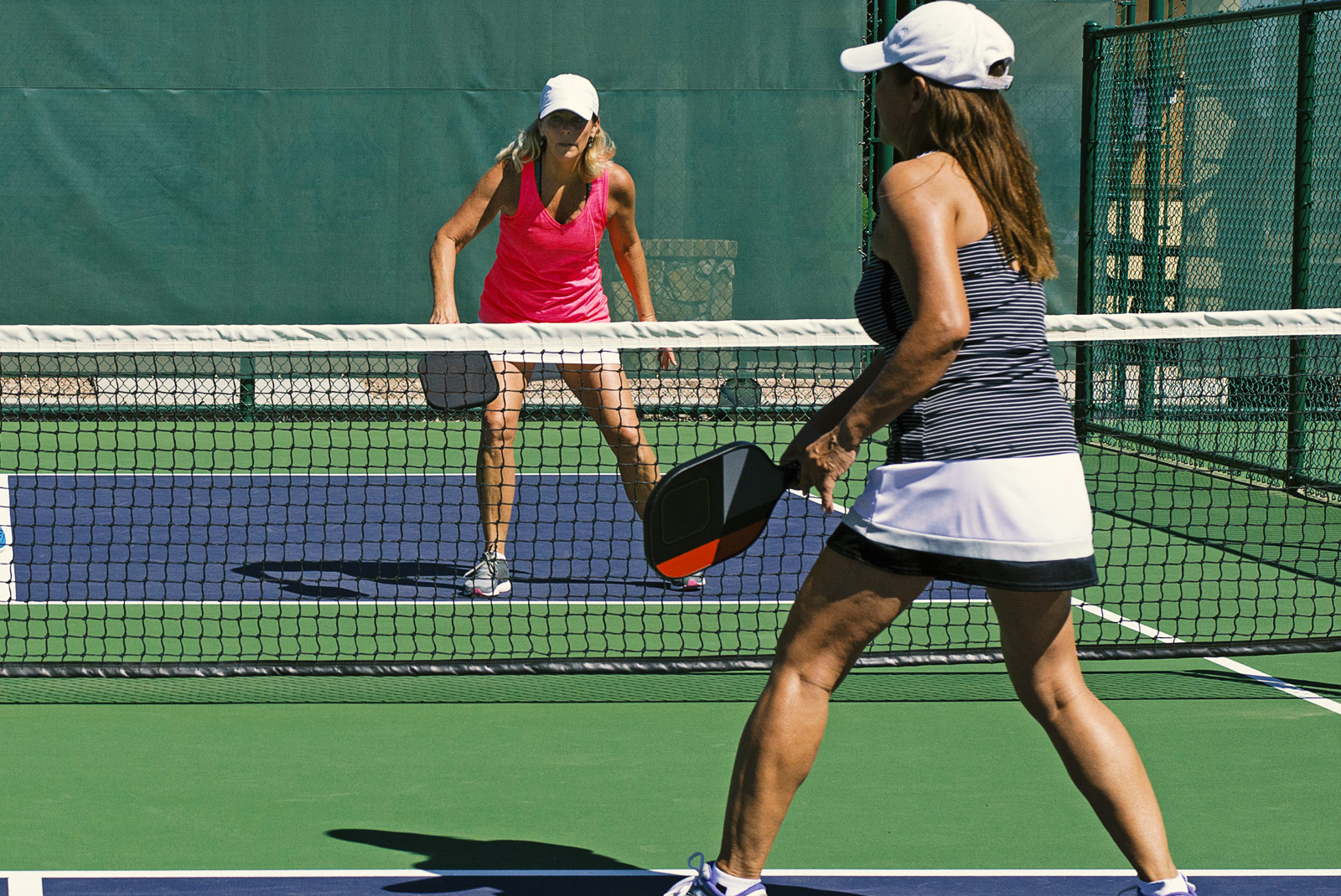 girls playing paddleball