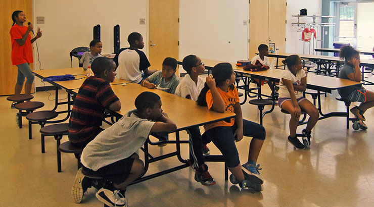 Youth sitting at tables - Plum Gar Community Recreation Center