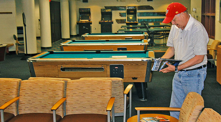 Man standing in game room - Potomac Community Recreation Center