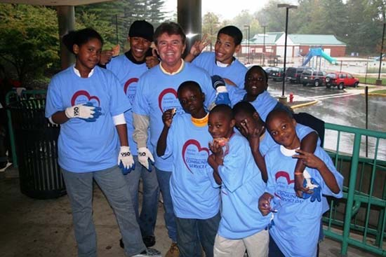 John McCarthy and kids wearing community service t-shirts